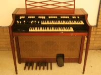 B&B ENTERPRISES & CONSTRUCTION HAS TWO HAMMOND ORGANS
