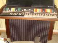 Automatic Hammond Piper Organ and bench. Works well.