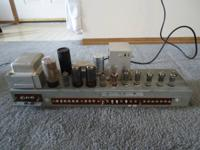 This is a sweet old vacuum tube amplifier from a