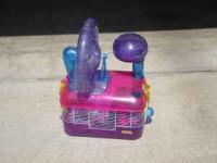 fancy hampster cage with excercise wheel and upper