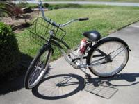 "Has 15"" Frame in green w/ white; 4 speed. Has basket,"