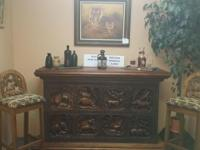 Beautiful Hand Carved bar...with two bar stools. Bar is