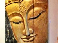 This 4 panels hand carved wood Buddha face came from