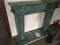 These are beautiful hand carved MARBLE mantles. The