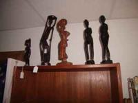 We have a nice collection of hand-carved, wood statues