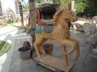 "42 X 54"" carved wooden horse came from a storage unit"