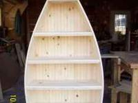 These hand-crafted bookshelf canoes are crafted from