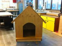 We built this dog house in the Evergreen woodshop for a