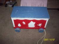 this is a hand crafted old, wooden toy box. It has the
