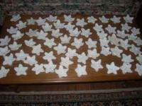 There are 65 new white hand-crocheted Christmas Stars
