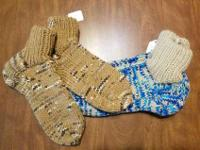 Two pair of hand-knitted slippers. Size: 9 women's