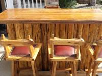Customized hand made cedar log bar and oak bar stools.