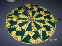 Hand made John Deere tree skirt. $10.00 cash. Call