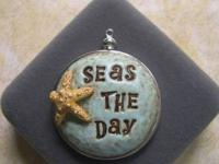 "An unique pendant hand made with the saying ""Seas The"