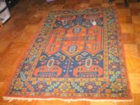 "RUG hand made in vibrant colors. Measures 48"" x 70""."