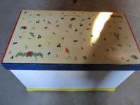A real wood- hand made toy box. 38 inches wide , 25