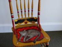 This intricate solid oak chair is hand painted front