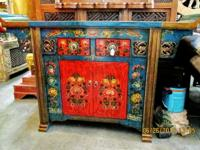 This beautiful hand painted cabinet came from Nyima