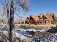 Custom scribe log home on Cottonwood Creek. Two acre