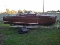 This boat was hand made out of Mahogany by my father.