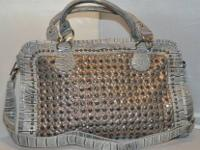Here's a handbag Avail (Silver) & (Grey) that has bling