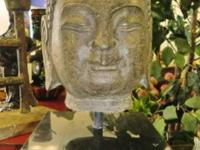 This beautiful dark stone Buddha head is hand carved