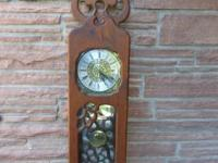 Beautiful large wall-hung clock, a rustic antique