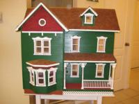 I built this dollhouse about 25 years ago from