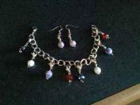 I have a handmade charm bracelet made with various