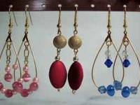 These are handmade earrings. Each pair is unique and
