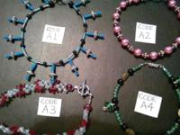 I HAVE A VARIETY OF HANDMADE (NEVER WORN) GLASS BEADED