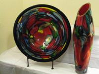This hand made platter and vase have brilliant colors