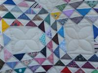 This is a King Size quilt in the Ocean Waves pattern.
