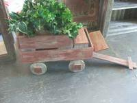 Handmade rustic wagon planter. All built from reclaimed
