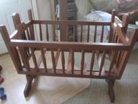 Handmade, solid wood cradle. Includes bed mattress. Has