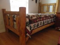 This is a handmade pine log bed purchased in Blue