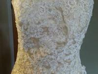 Handmade wedding dress.  Never worn approximately size