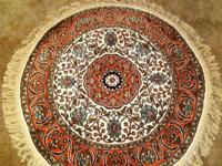 This is a new pure silk round rug that was hand made in