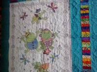 This frog blanket was hand stitched by me and sewn onto