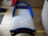 WE ARE SELLING A LIKE NEW HANDY MANNY TODDLER BED VINYL