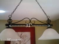 An intricate swirl design makes this wrought iron