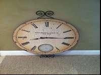 I'm selling a large hanging wall clock. Frame is