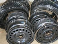 4 Studded Snow tires with rims. $100.00 Studded snow