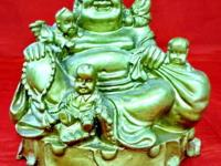 This clay sculpture of the Happy Buddha with the