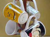 Happy faces hot drink set, 4 coffee mugs and stand Look