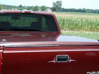 Fiberglass tonneau cover for a pick up truck . Burgendy