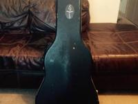 I have a standard size acoustic guitar hard case, a