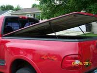 Bright red hard tonneau cover. Fits 97-03 Ford F-150