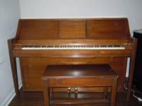 45 year old player piano with about 30 paper roll