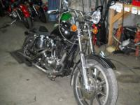 Shovel sporty of custom biker build. Nice laid back